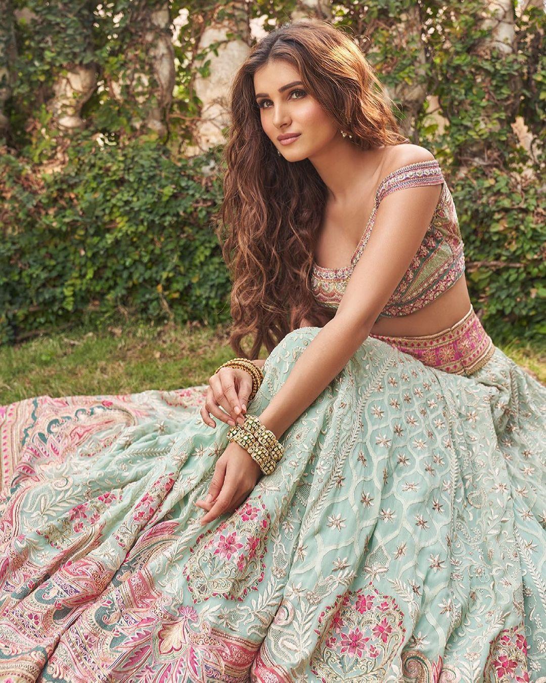 Bollywood Actress Tara Sutaria sizzles ethnic fashion in Holi Chikankari lehenga